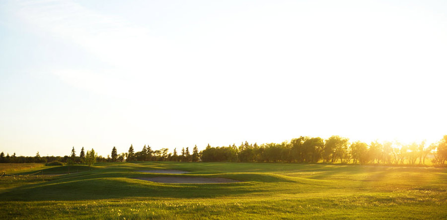 sunset over a golf course