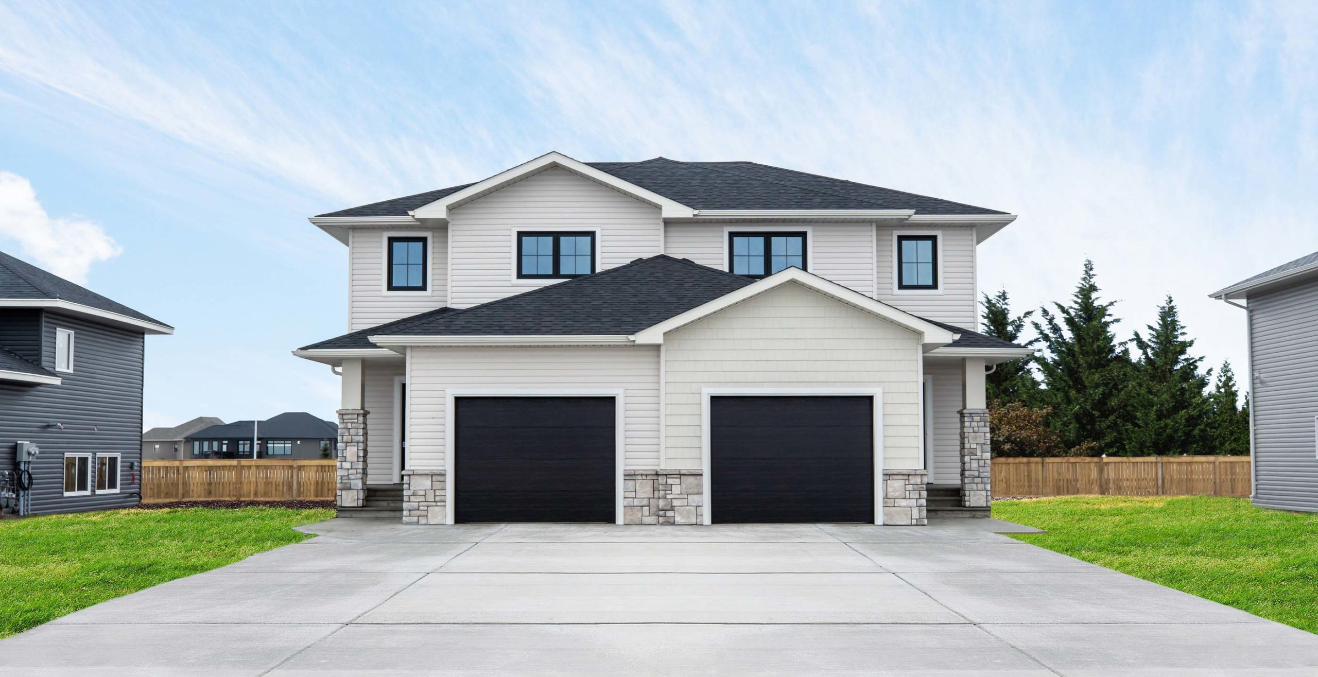 One of the available North Point Homes, two-story duplex with garages