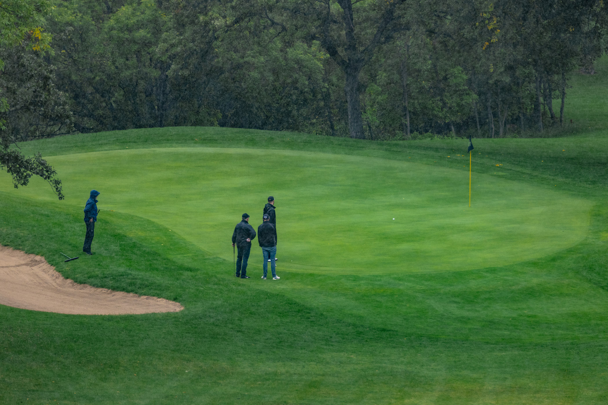 aerial shot of a group watching a shot on the green